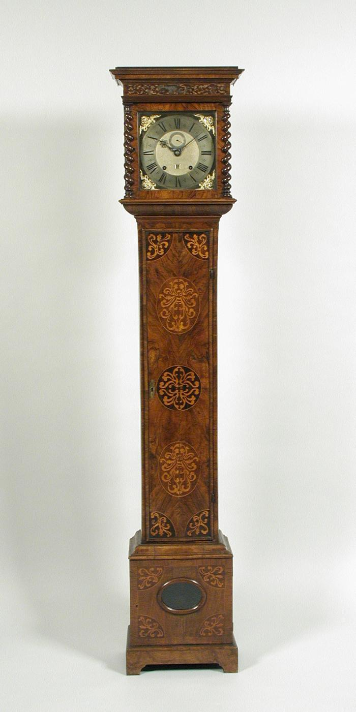 Front view of longcase clock showing marqueted vegetal motifs