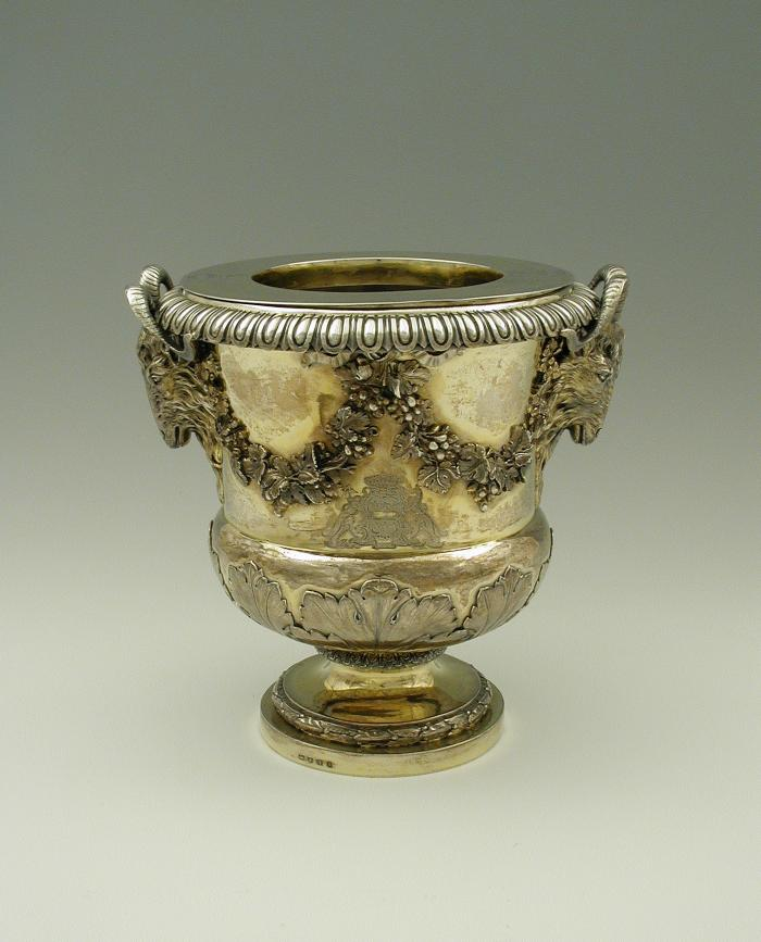 Gold and silver wine cooler with plant designs and rams' heads