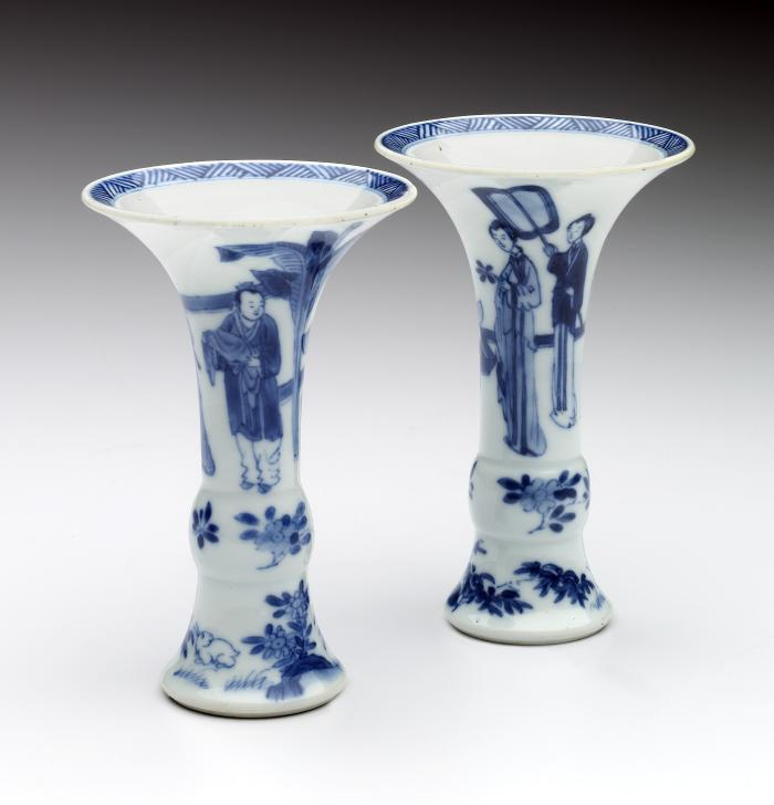 Two white hard-paste porcelain beaker vases with underglaze blue figural  decoration, side view