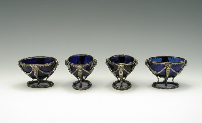 Photograph of four blue bowls with silver mounts