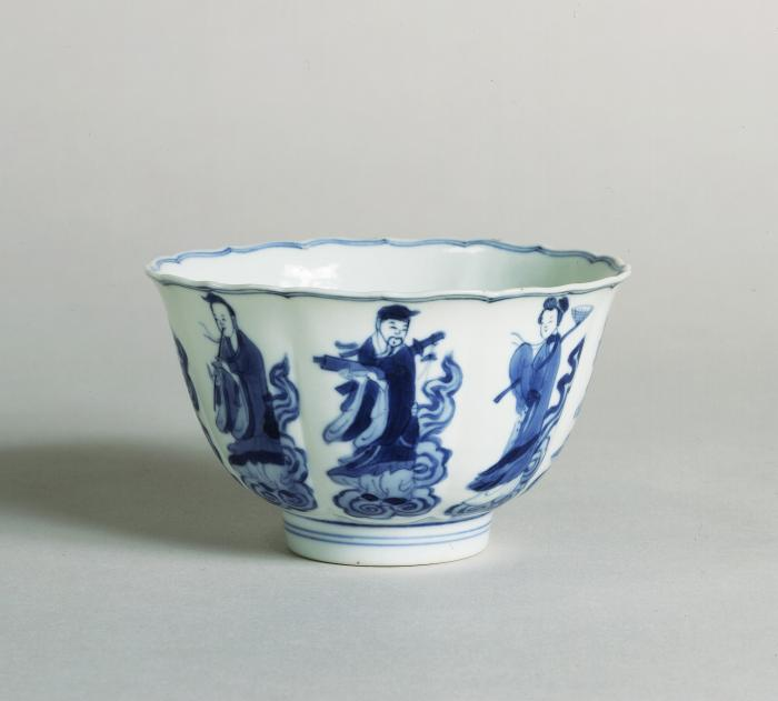 Blue and white porcelain barbed and lobed bowl showing eight robed figures.