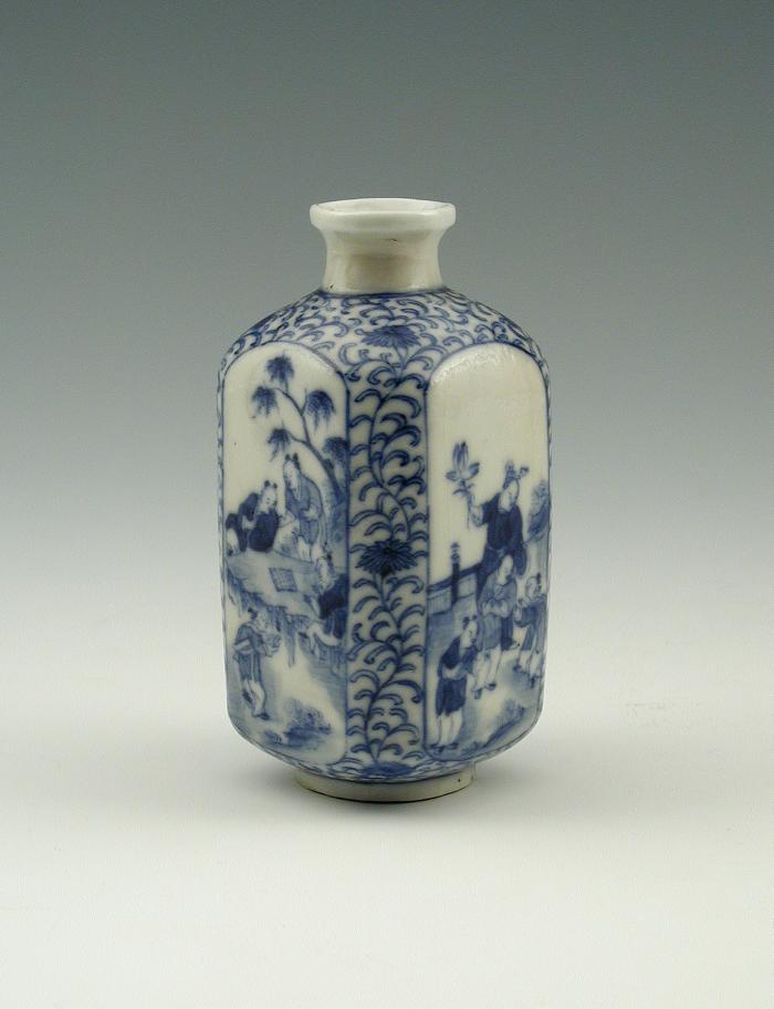 White and blue soft-paste porcelain vase with figural decoration
