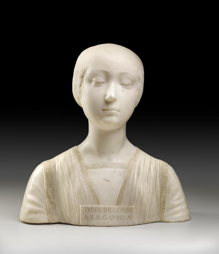 A marble bust of the Beatrice of Aragon.  Her hair is neatly wrapped behind her head, and her eyes are semi-closed.