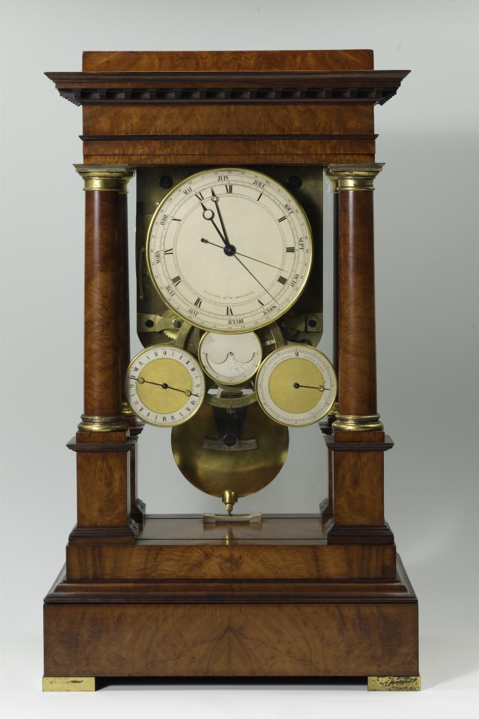 Front view of Mantel Regulator Clock showing the four suspended dials supported by a wood frame with tuscan columns