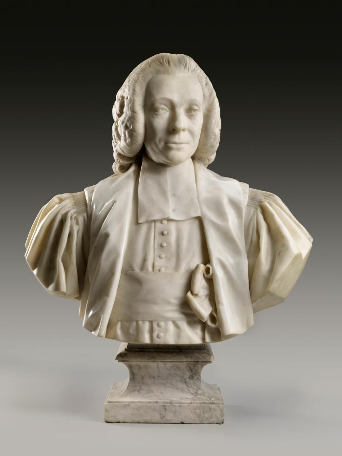 Marble sculpture of Armand-Thomas Hue, Marquis de Miromesnil.  His head is slightly shifted to his left and he wears a fancy wig.  He wears layers of stiff, heavy cloth, with ample sleeves swelling from pleated shoulders, the high, tight collar falls in straight lappets, with a neatly buttoned cassock.