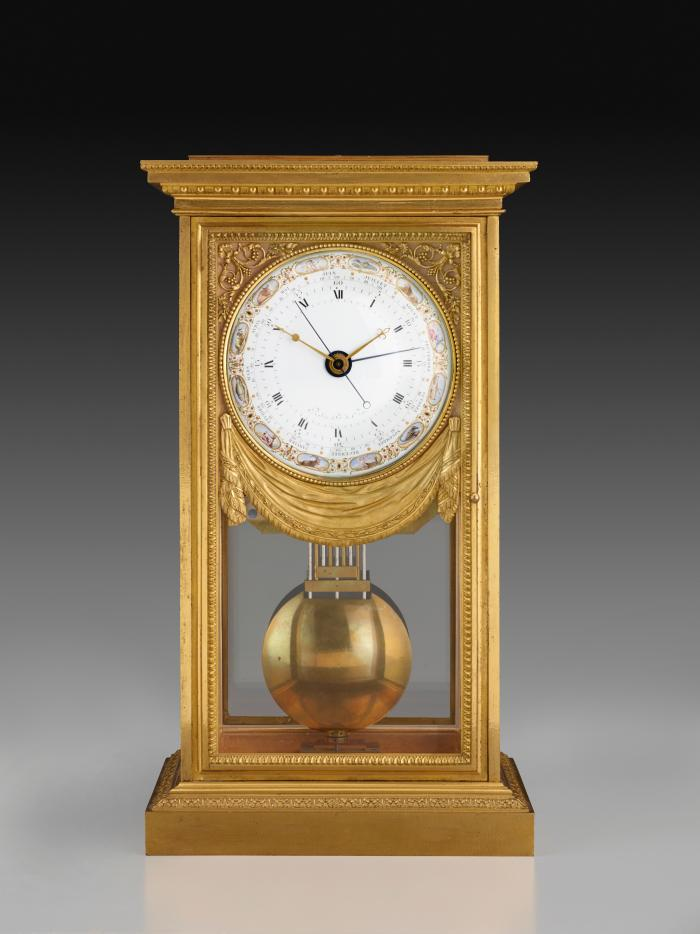 Front view of Mantel Regulator Clock Showing Mean and Solar Time through a polychrome enamel dial offset by a gilt bronze case of neoclassical design