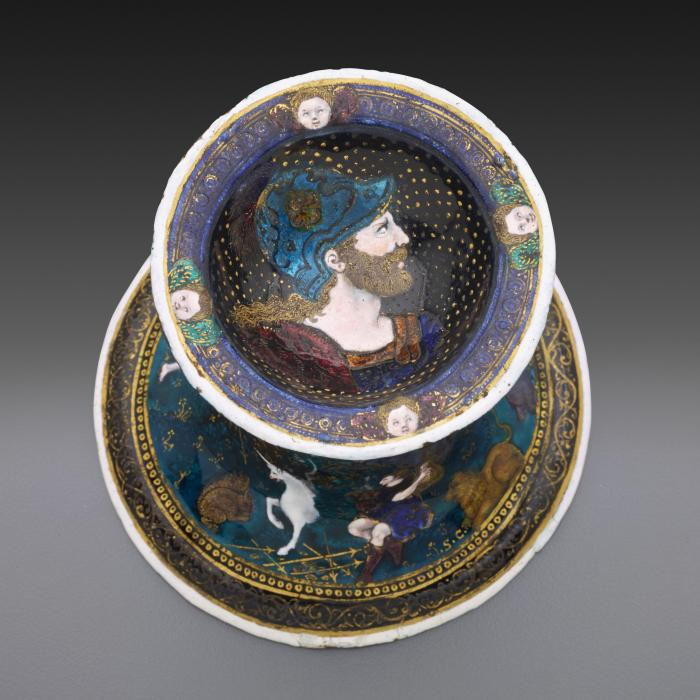 View from above of one of a pair of saltcellars made from polychrome enamel, showing the profile of a young warrior