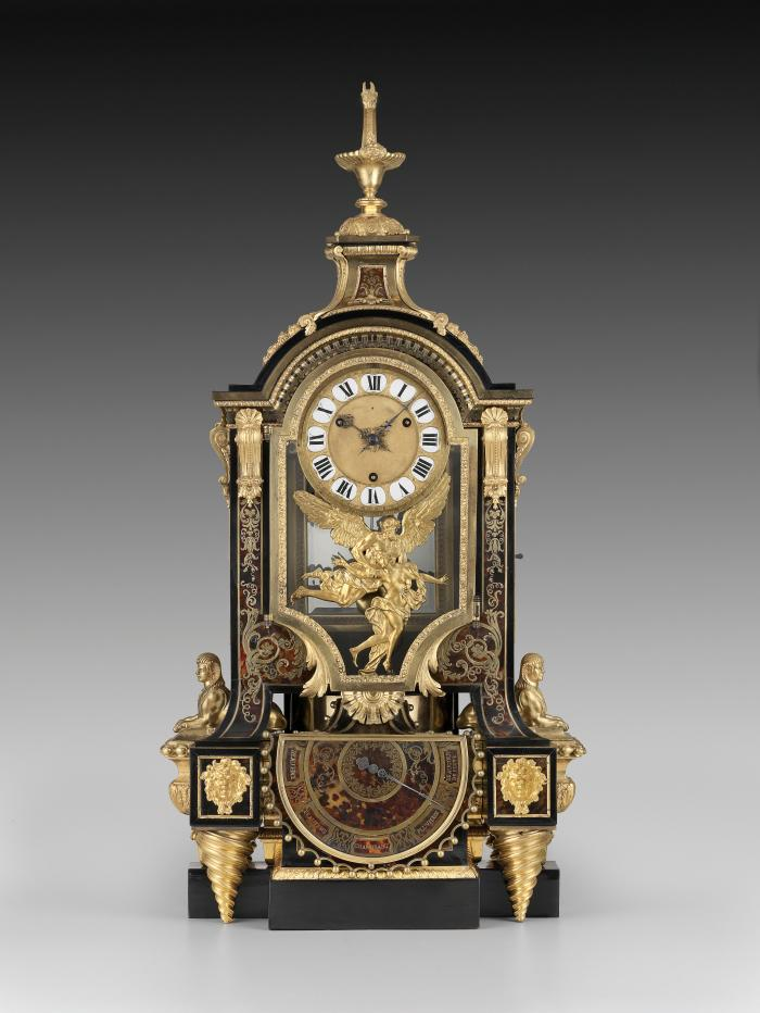 Front view of Barometer Clock with Boulle marquetry consisting of inlaid tortoiseshell, pewter, and gilt bronze, set against ebonized wood. Beneath the enameled dial are two figures in gilt bronze, one a young female and the other an old man with wings, representing the passing of time