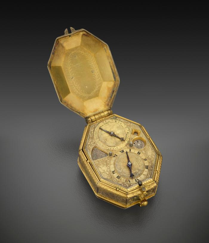 View from above of Calendrical and Astronomical Pendant Watch in gilt bronze, opened to reveal the dials