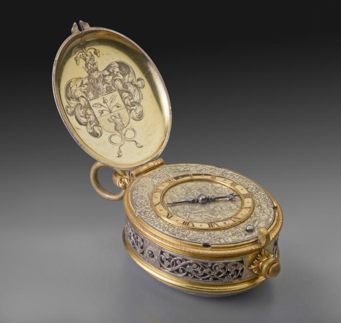 Image of Silver gilt Pendant Clock opened to reveal the dial on the intricately carved body of the clock and a coat of arms on the underside of the lid