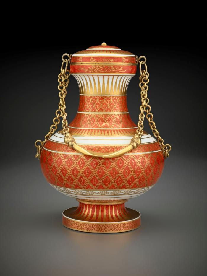 Red and gold porcelain vase with lid and gold chain