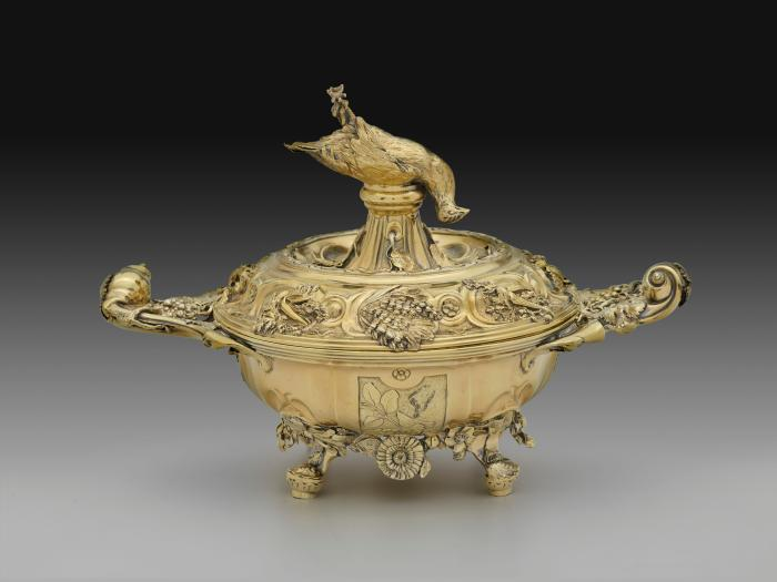 Gilt silver soup tureen with inverted dead pheasant and intricate design