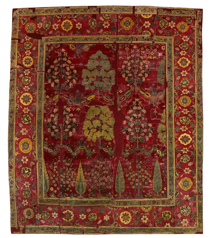 Dark red square Indian rug with design of trees and flowers