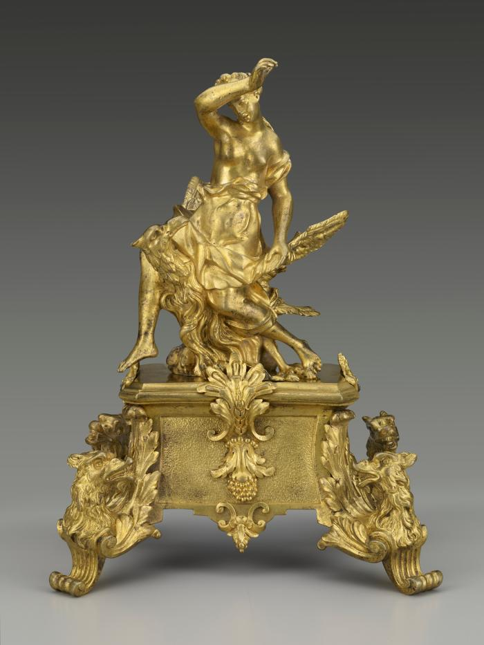 Gilt bronze andiron with female figure seated on the back of an eagle, with supports in the form of birds