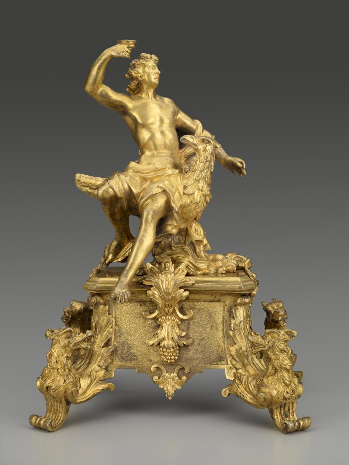 Gilt bronze andiron with male figure seated on the back of an eagle, with supports in the form of birds