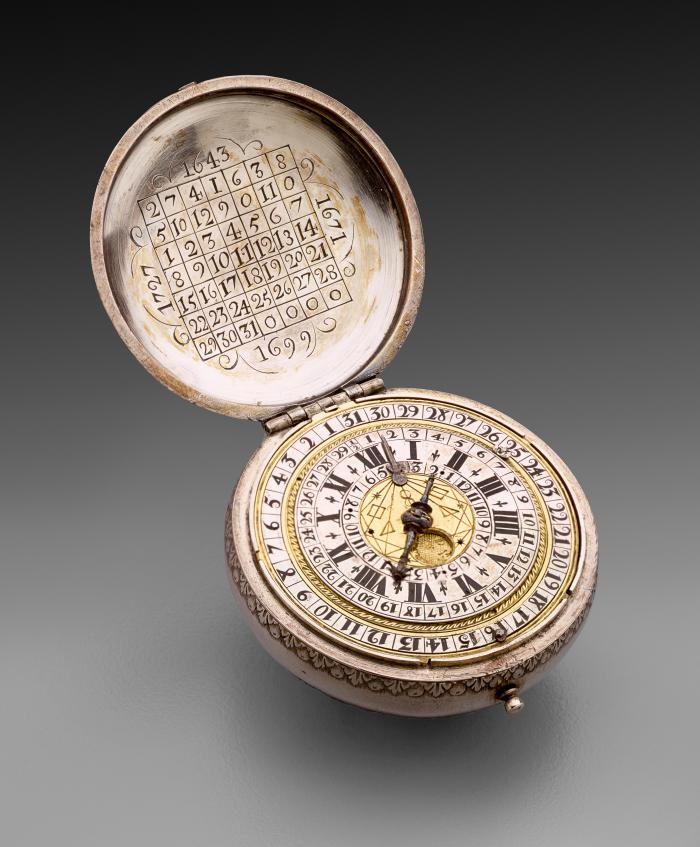 Image of Silver Case Verge Watch displayed open to reveal the dial and underside of the lid, both intricately carved with numbers