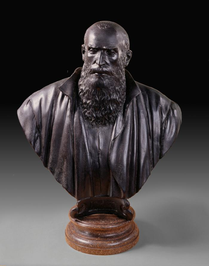 A bronze bust of a jurist.  He looks out slightly to his right, his hair is thinning at the top and he has a mid-length wavy haired beard.